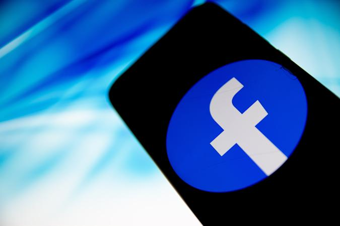 In this photo illustration Facebook logo is displayed on a smartphone screen in Athens, Greece on April 13, 2021 (Photo Illustration by Nikolas Kokovlis/NurPhoto via Getty Images)