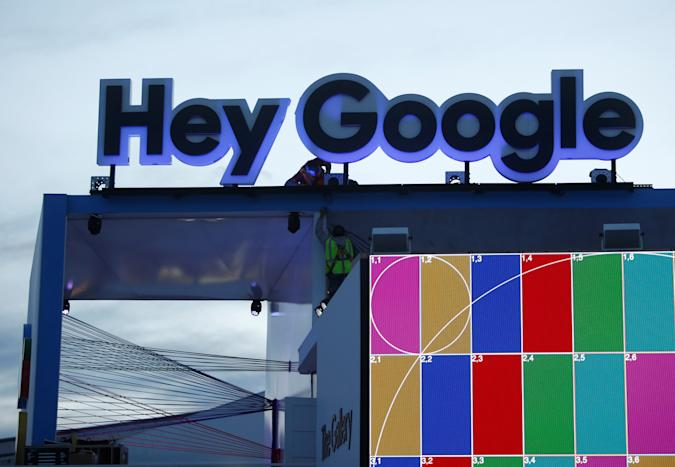Workers set up a Hey Google booth at the Las Vegas Convention Center in preparation for the 2018 CES in Las Vegas, Nevada, U.S. January 6, 2018. REUTERS/Steve Marcus