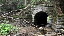 Unusual granite culvert from 1800s is collapsing. Community wants it saved