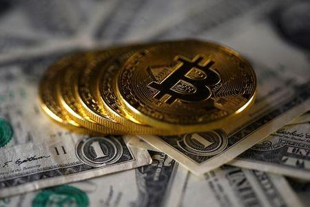 FILE PHOTO - Bitcoin (virtual currency) coins placed on Dollar banknotes are seen in this illustration picture, November 6, 2017. REUTERS/Dado Ruvic/Illustration