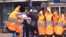 Biker and man in traffic cone costume caught fighting in Colombia