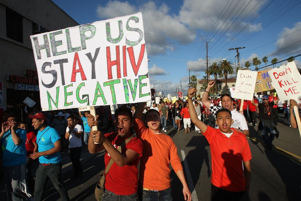 A cure for HIV remains elusive, but scientists say the hunt is more hopeful than ever (AFP Photo/David Mcnew)