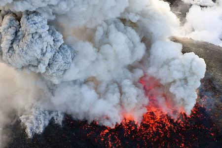An aerial view shows Shinmoedake peak erupting between Miyazaki and Kagoshima prefectures, southwestern Japan, in this photo taken by Kyodo March 6, 2018. Mandatory credit Kyodo/via REUTERS