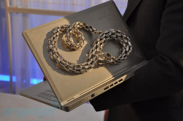 Douglas Little's Adamo series: the most expensive snake you've seen glued to a laptop all week