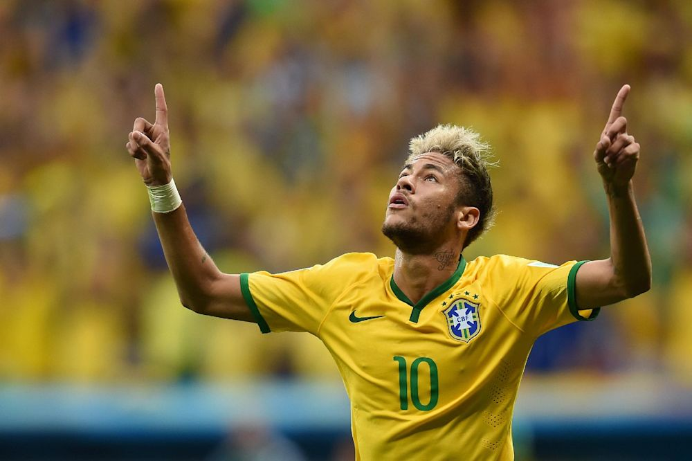 Brazil's forward Neymar celebrates after scoring a second goal during the match between Cameroon and Brazil at the Mane Garrincha National Stadium in Brasilia on June 23, 2014