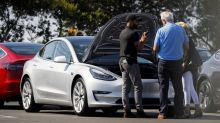 Tesla revives popular customer-referral program