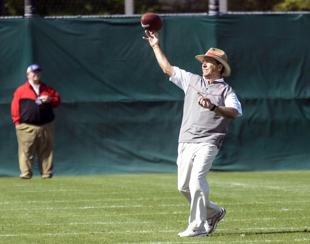 Alabama head coach Nick Saban throws during NCAA college spring football practice on Friday, April 11, 2014, at the Thomas-Drew Practice Facility in Tuscaloosa, Ala