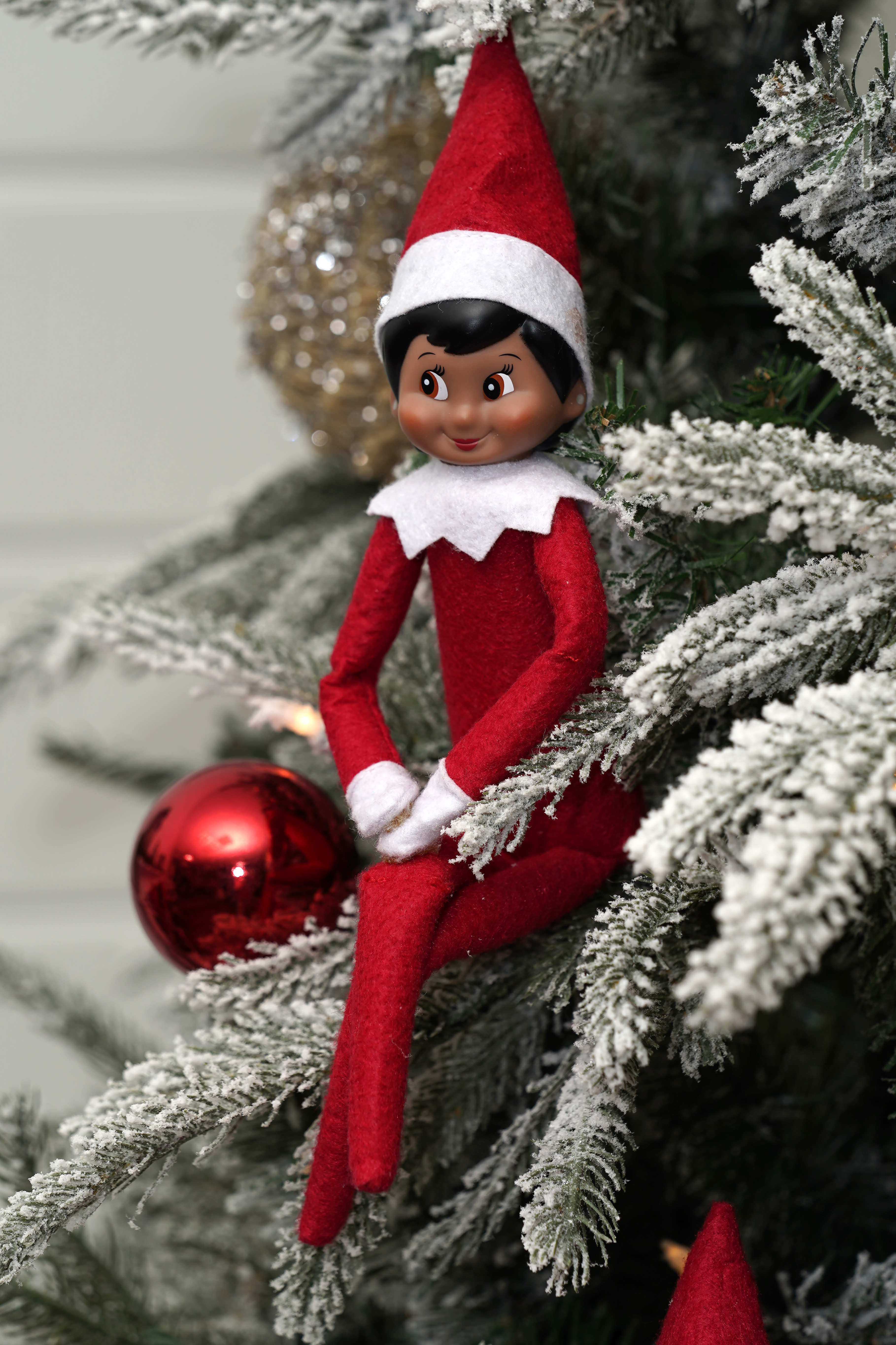 Elf on the Shelf figures are displayed at the company's studio Thursday, Aug. 27, 2020, in Atlanta. Thousands of suppliers routinely rely on credit insurance to cover potential losses if any of the retailers they work with can't pay for the goods they've ordered. But now insurers are scaling back on coverage because they are unwilling to take a chance on retailers that are struggling to survive during the pandemic. Christa Pitts, founder and co-CEO of The Lumistella Company, which produces toys, books and other products under the Elf on the Shelf and Elf Pets brands, says her retail orders were covered 100% before the pandemic. Now, only 50% are covered, forcing her to rethink who she will sell to. (AP Photo/John Bazemore)