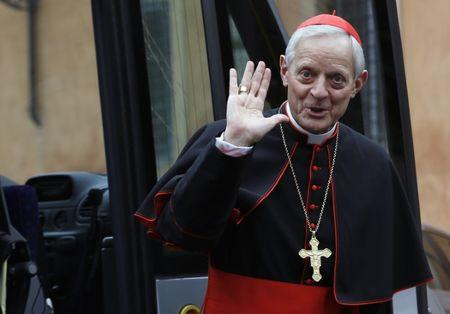 FILE PHOTO: Cardinal Wuerl from U.S. waves as he arrives for a meeting at the Synod Hall in the Vatican
