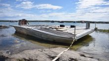 This barge is moored on the shore of a Yellowknife city park — and nobody can do anything about it