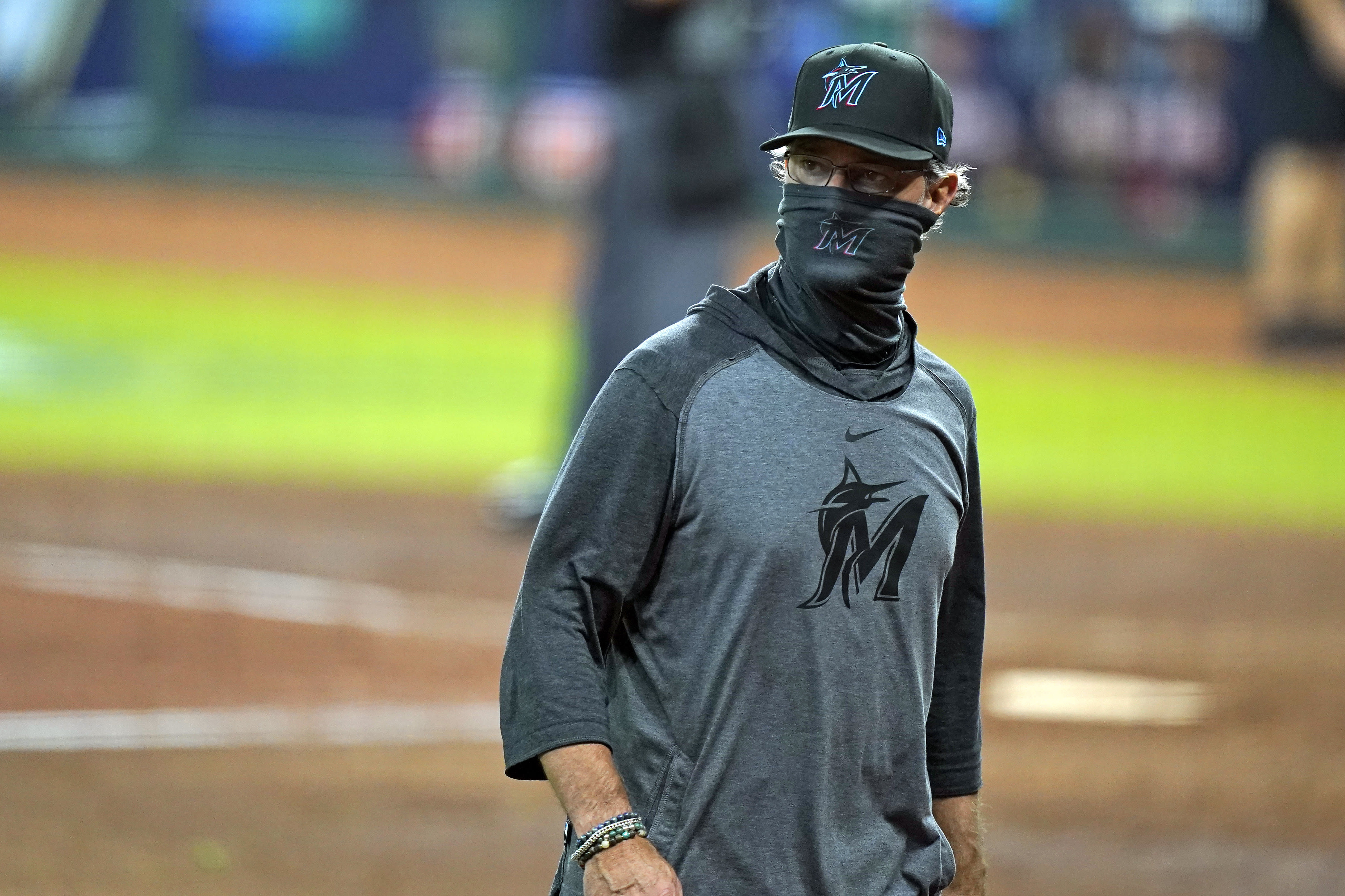 Miami Marlins manager Don Mattingly walks back to the dugout after a pitching change in the fifth inning in Game 3 of a baseball National League Division Series against the Atlanta Braves, Thursday, Oct. 8, 2020, in Houston. (AP Photo/David J. Phillip)