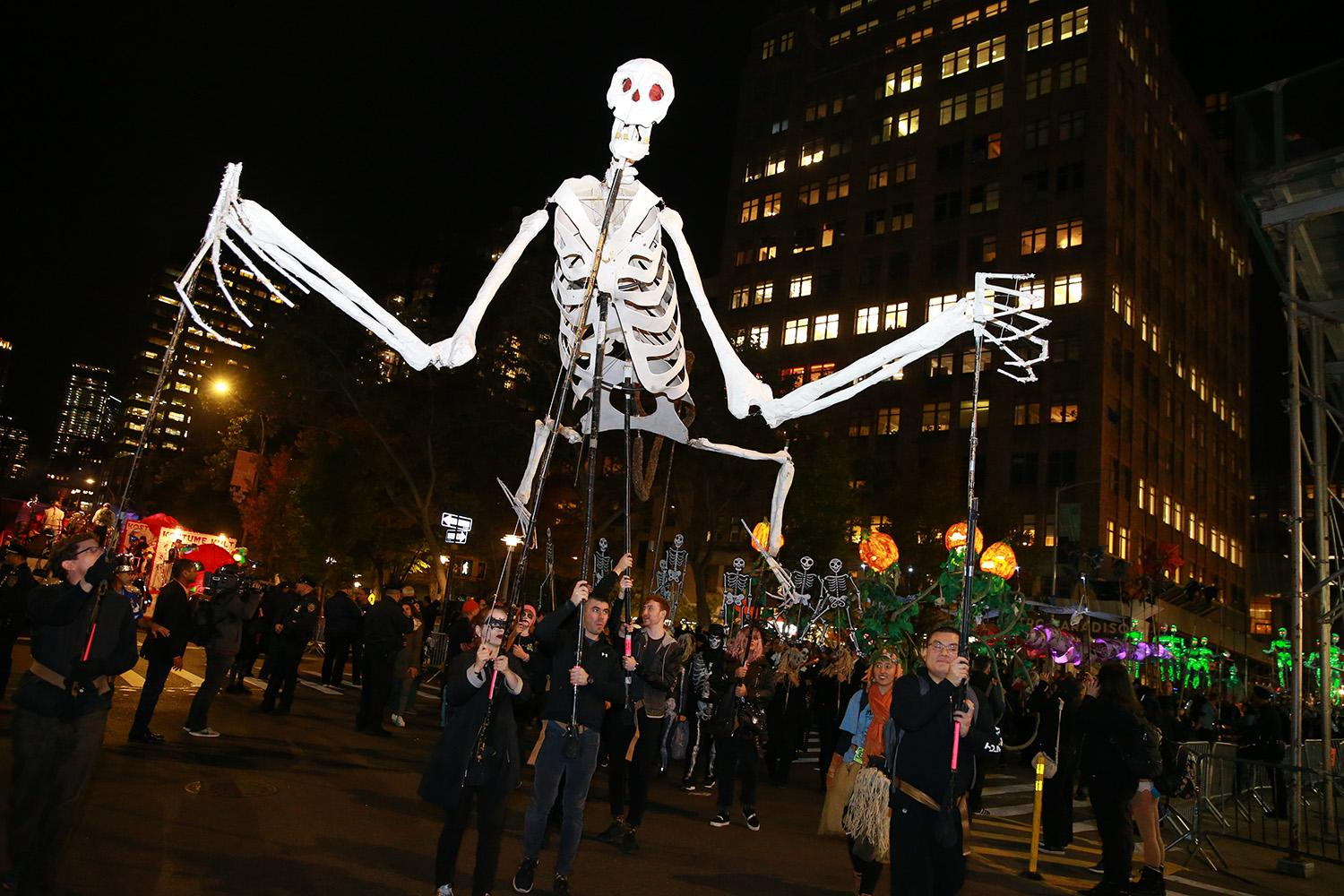 <p>Revelers march and carry goblins during the Greenwich Village Halloween Parade in New York, Oct. 31, 2018. (Gordon Donovan/Yahoo News) </p>
