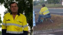Man sits on traffic island with sign in desperate search for work