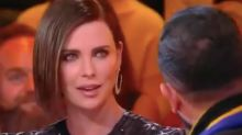Charlize Theron calls out French TV host for kissing interpreter without permission