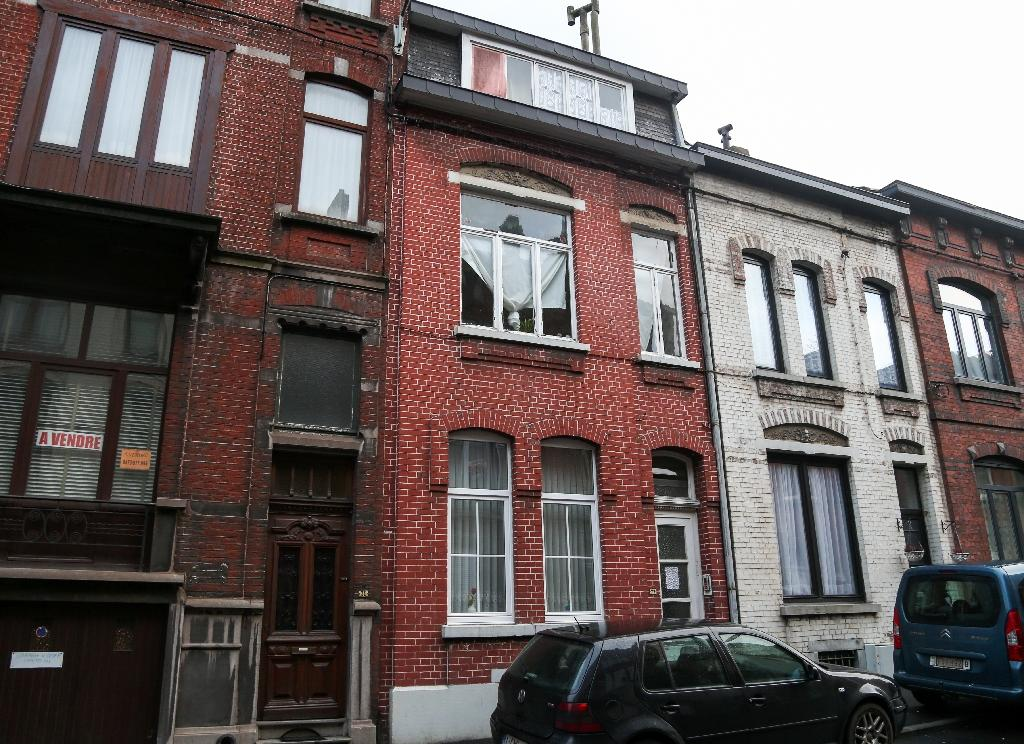 A picture taken on January 13, 2016 shows a house (C) in Charleroi identified by Belgian police as a safe house used by key suspects in the November 13 Paris attacks (AFP Photo/Virginie Lefour)