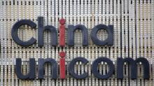 China regulator says Unicom reform plan does not violate rules, shares surge