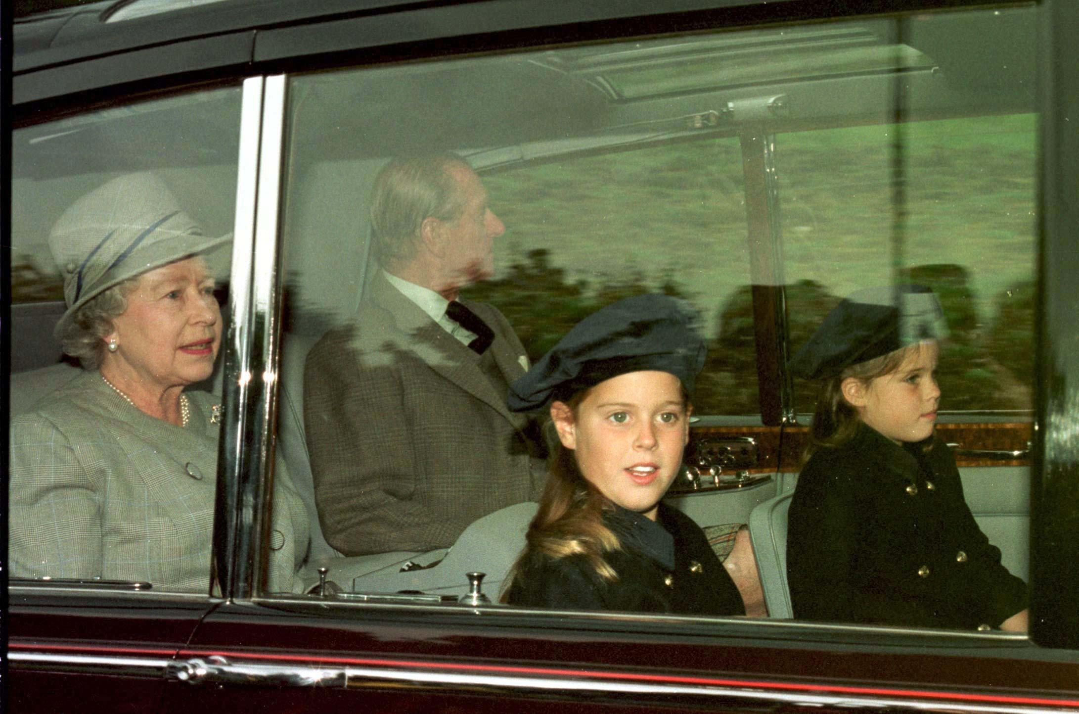 The Queen and Duke of Edinburgh with their grandchildren Princess Beatrice and Princess Eugenie (right) leaving Balmoral castle this morning (Monday) en route to Crathie Kirk church for memorial in memory of Diana, Princess of Wales. Photo by Owen Humphreys/PA. See PA story DIANA Anniversary