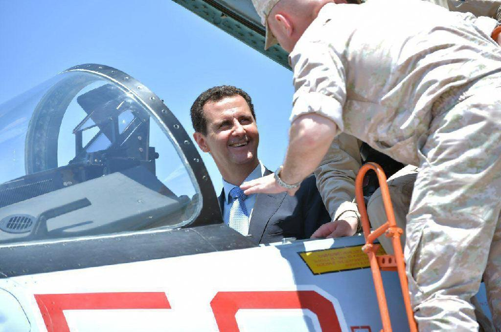 A handout picture released by the Syrian presidency on June 27, 2017 shows President Bashar al-Assad sitting inside a Sukhoi Su-27 during a visit to the Hmeimim military base (AFP Photo/-)