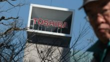 Toshiba reports long-delayed earnings, posts $8.8 bn loss