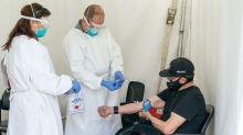 Experts Warn of New Virus Surge