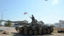 Syrian govt troops mass in northwest after gains