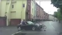 Shocking moment cyclist punches a driver following a collision
