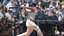 Mariners pull closer in wild card race, hold off A's 4-3
