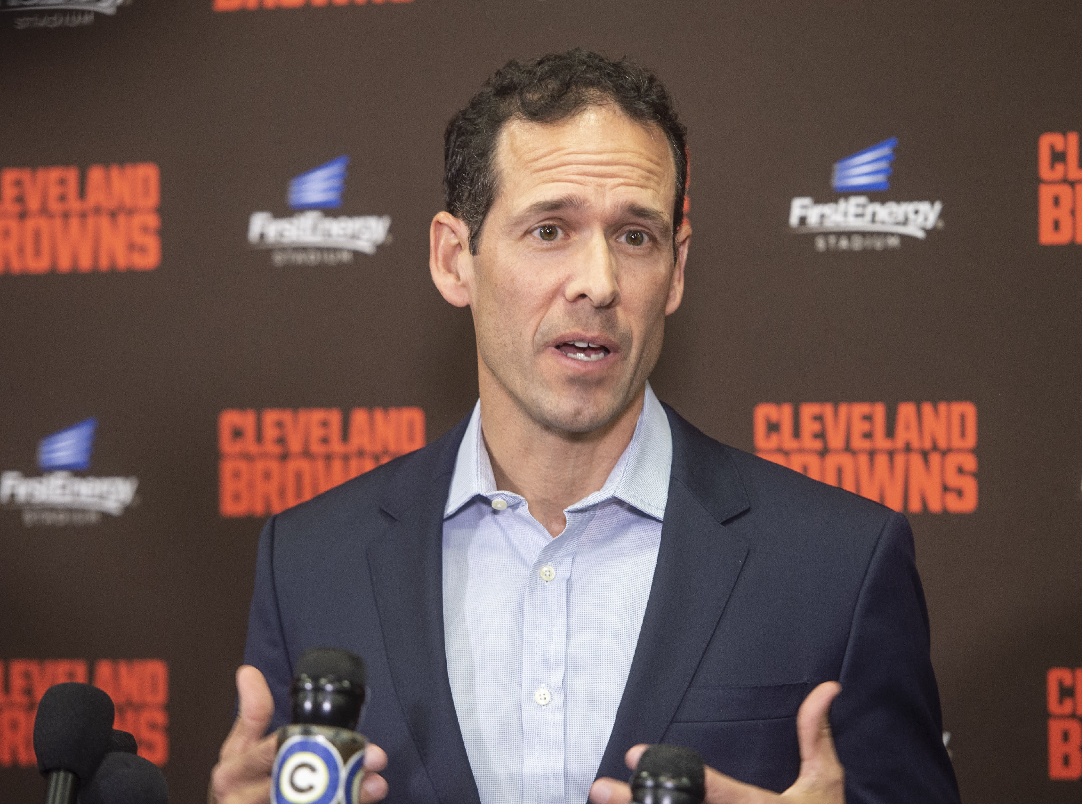 Paul DePodesta, chief strategy officer for the NFL football Cleveland Browns answers a question during a news conference at FirstEnergy Stadium in Cleveland, Tuesday, Jan. 14, 2020. (AP Photo/Phil Long)