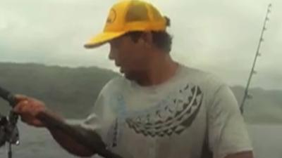 Raw: Hawaii Fisherman Gets Up Close With Shark