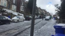 Sheffield residents slide down icy road on way to work
