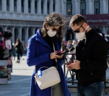 Italy plays down coronavirus risk as death toll rises, cases jump