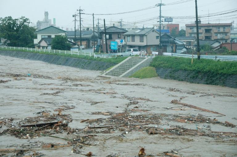 Japan's weather agency issued the highest emergency level of heavy rain warnings for Kumamoto and Kagoshima on Kyushu island (AFP Photo/STR)