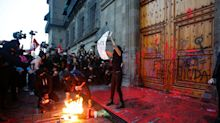 Photos show how fiery protesters using fake blood took over Mexico City in response to the rise of brutal killings of women