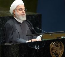 Iran's President Rouhani reportedly threatened to resign over attempts to cover up downing of airliner