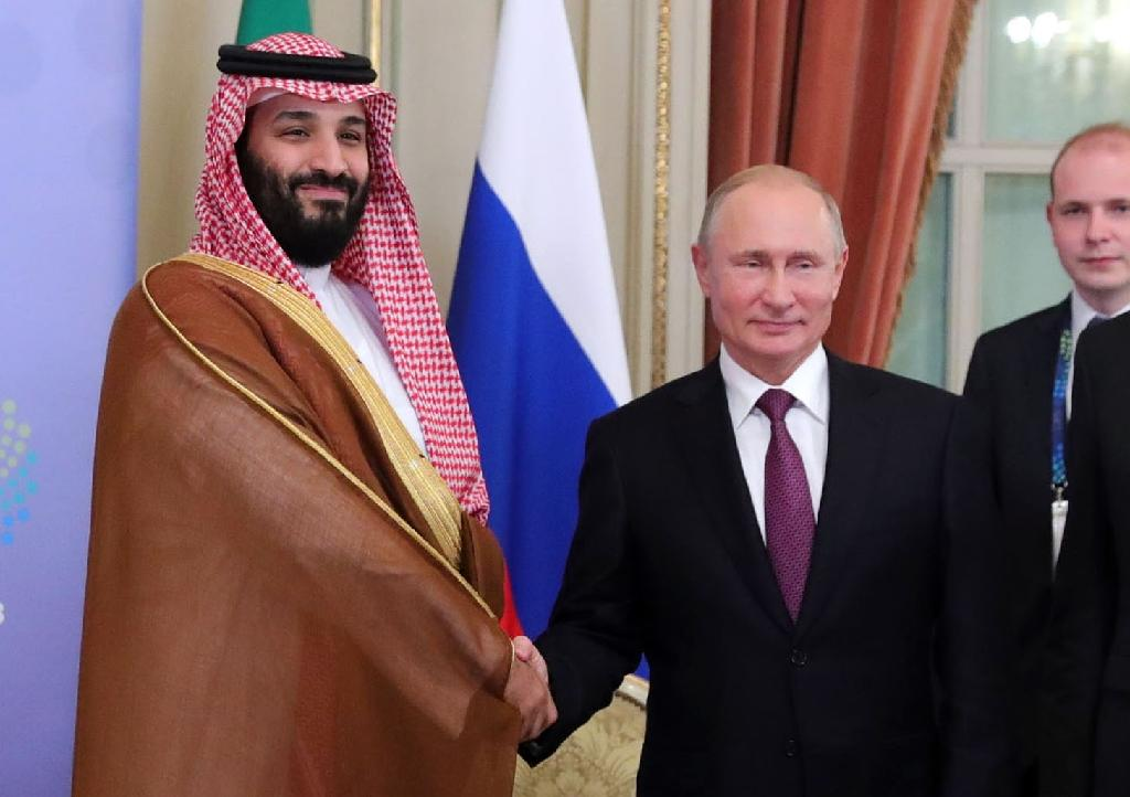 Saudi Arabia's Crown Prince Mohammed bin Salman (L) and Russia's President Vladimir Putin shake hands during a bilateral meeting on the second day of the G20 Leaders' Summit in Buenos Aires, on December 01, 2018