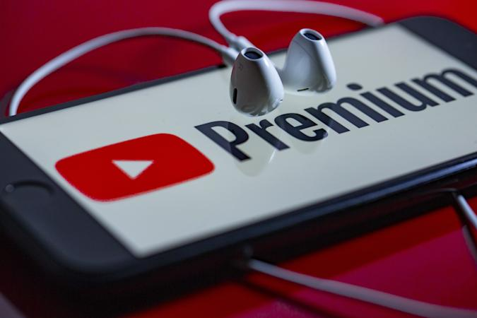 ANKARA, TURKEY - NOVEMBER 26: YouTube Premium logo is being displayed in a smart phone and an earphone is seen in Ankara, Turkey on November 26, 2019. (Photo by Aytac Unal/Anadolu Agency/Getty Images)