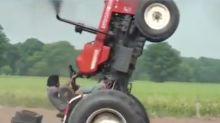 Farmer performs wheelies in his tractor
