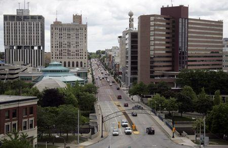 Traffic goes by in downtown Flint, in Michigan