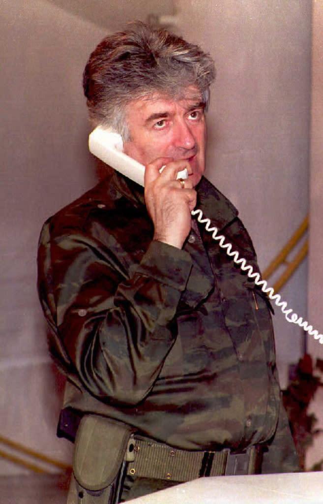 A file photo taken in August 1995 shows Bosnian Serb leader Radovan Karadzic talking on the phone about the latest developments in Banja Luka (AFP Photo/Milos Kecman)
