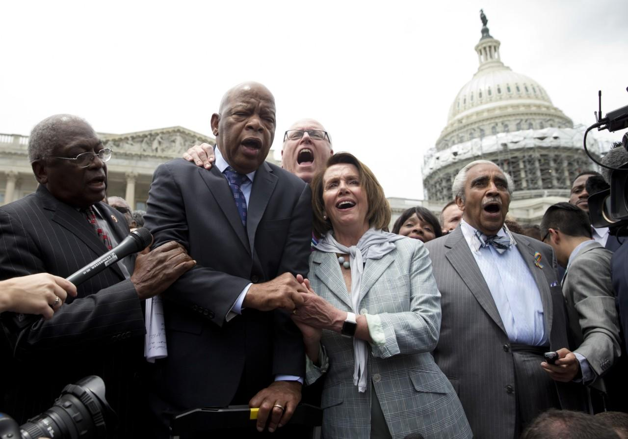 """<p>From left, House Assistant Minority Leader James Clyburn of S.C., Rep. John Lewis, Rep. Joseph Crowley, House Minority Leader Nancy Pelosi of Calif. and Rep. Charles Rangel, sing """"We Shall Overcome"""" on Capitol Hill in Washington, June 23, 2016, after House Democrats ended their sit-in protest. (AP Photo/Carolyn Kaster) </p>"""