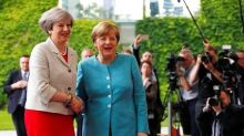 May, Merkel agree citizens' rights must come first in EU talks-Britain