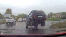 Bizarre moment Lada axle comes off while crossing railway track
