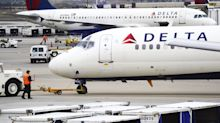 Son of Delta Passenger with Multiple Sclerosis Says Mom Was Tied to Wheelchair by Airline Employees