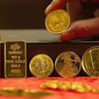 Gold prices eke out record high, but pull back from intraday peak near $2,010 as U.S. dollar firms