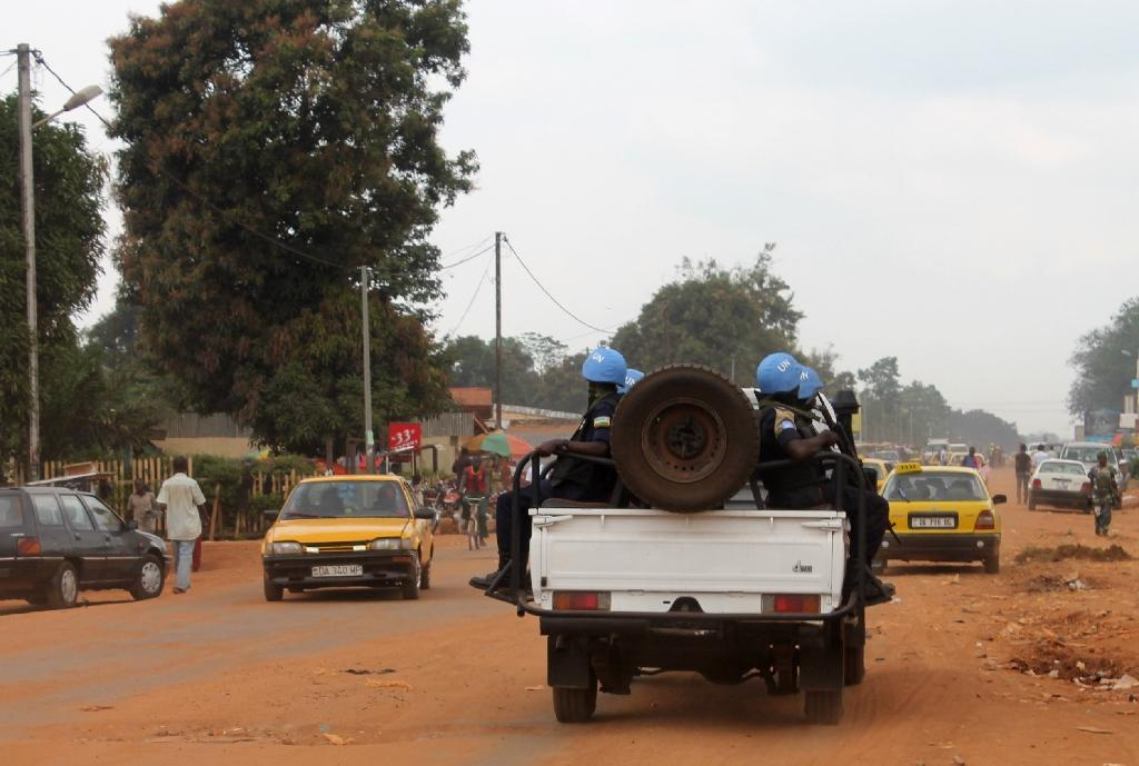 Soldiers of the UN force MINUSCA on a vehicle on September 15, 2014 in Bangui (AFP Photo/Pacome Pabandji)