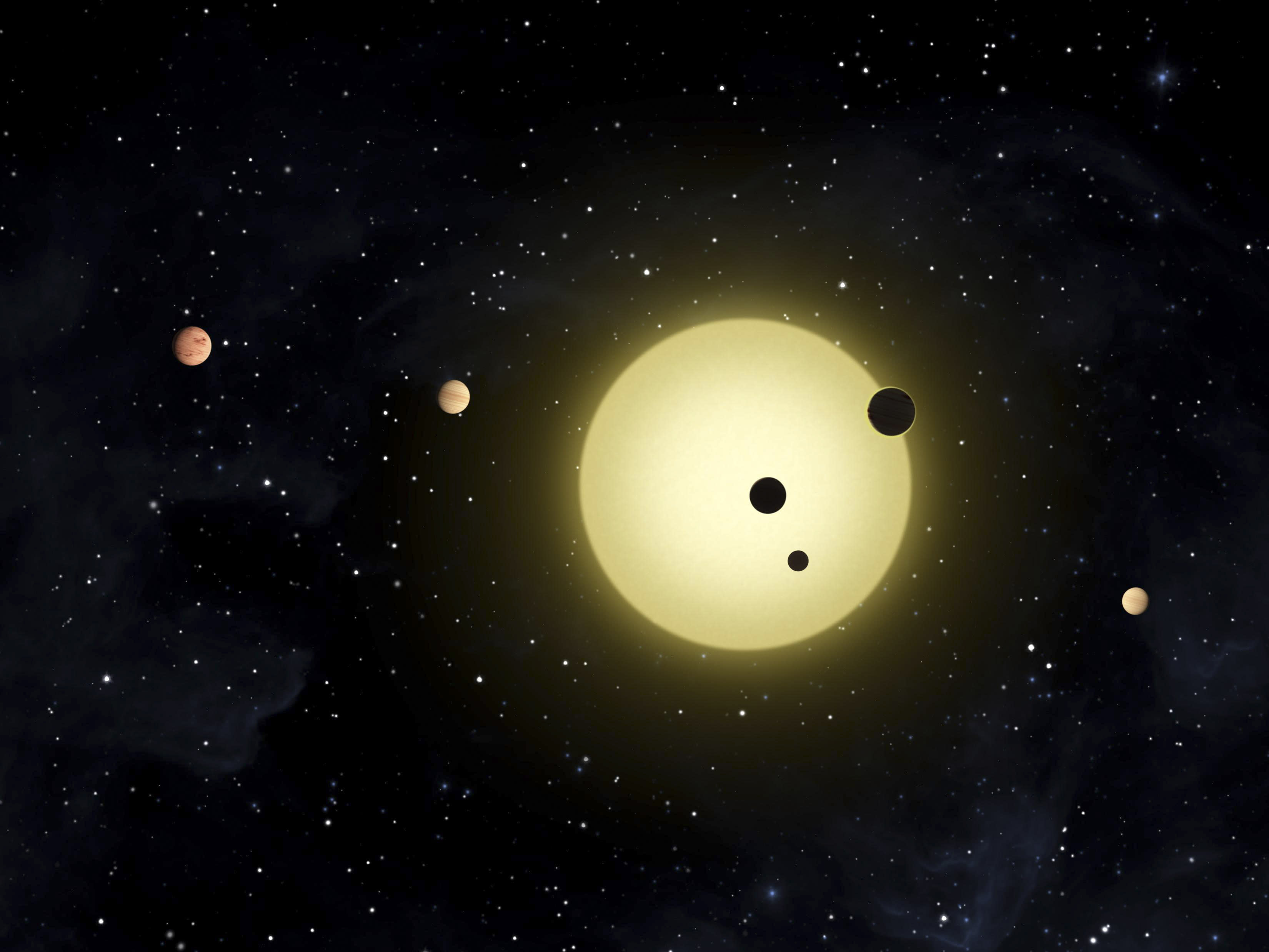 In this artist's conception released by NASA February 2, 2011, Kepler-11 is a sun-like star around which six planets orbit. At times, two or more planets pass in front of the star at once, as shown in a simultaneous transit of three planets observed by NASA's Kepler spacecraft on August 26, 2010. REUTERS/Tim Pyle/NASA/Handout