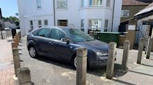 The London parking space you don't want: Ford Focus stuck for two weeks after builders install bollards
