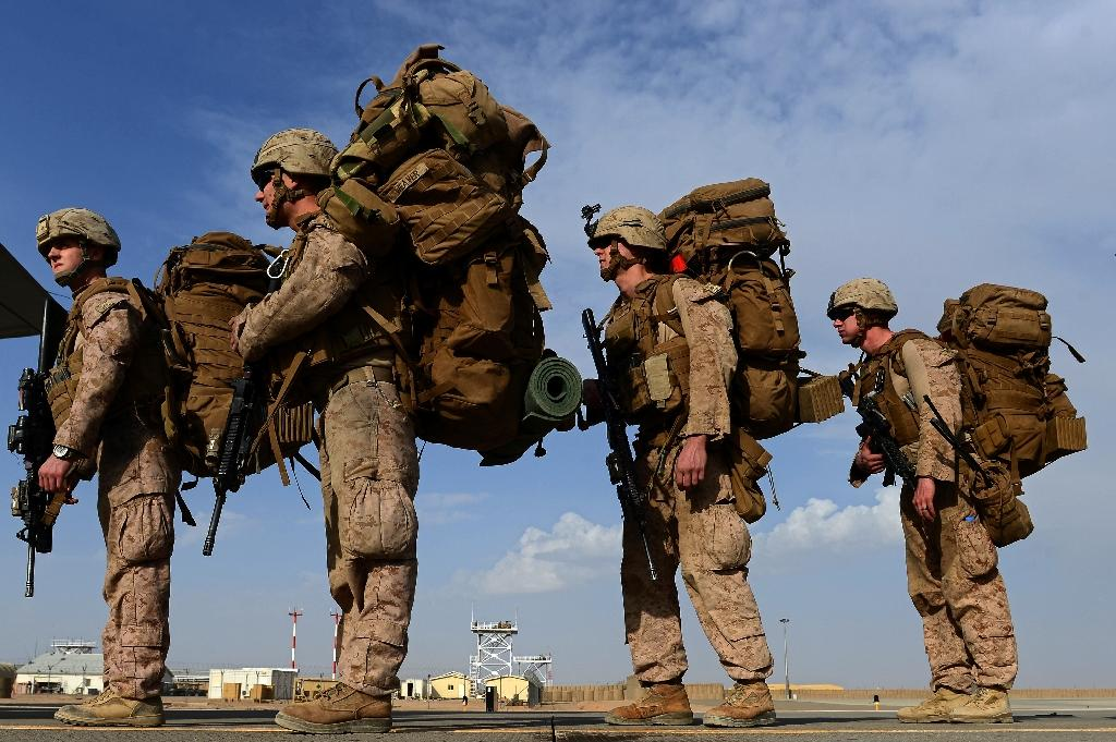 US Marines board a plane to Kandahar as British and US forces withdraw from the Camp Bastion-Leatherneck complex in Afghanistan's Helmand province in October 2014 (AFP Photo/Wakil Kohsar)