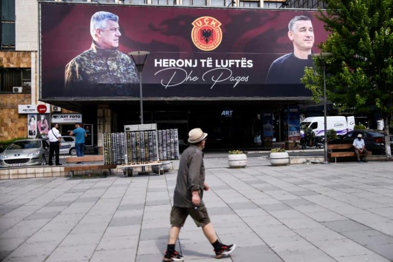 "Billboards in Pristina proclaim Kosovo President Hashim Thaci, left, and ex-parliament speaker Kadri Veseli as ""heroes of war and peace"" (AFP Photo/Armend NIMANI)"
