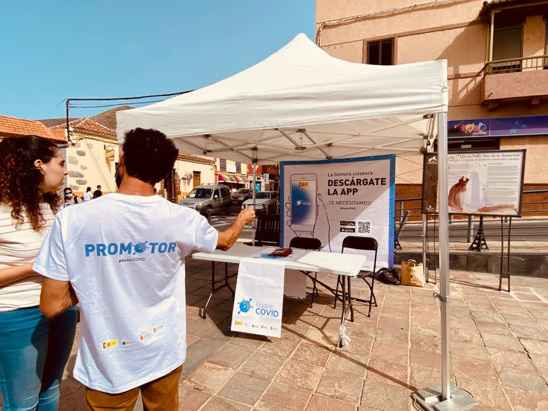 Volunteers show residents how to install an app to trace contacts with people potentially infected with the coronavirus disease (COVID-19) being trialled on the Canary Island of La Gomera